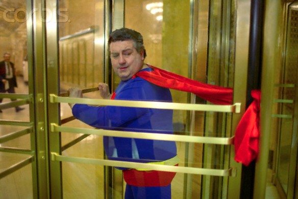 Superhero's cape stuck in revolving door
